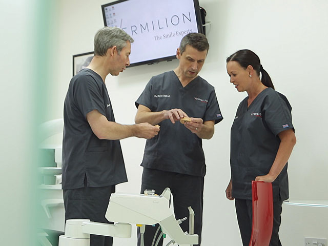 Vermilion dental experts discussing a dental implant treatment.